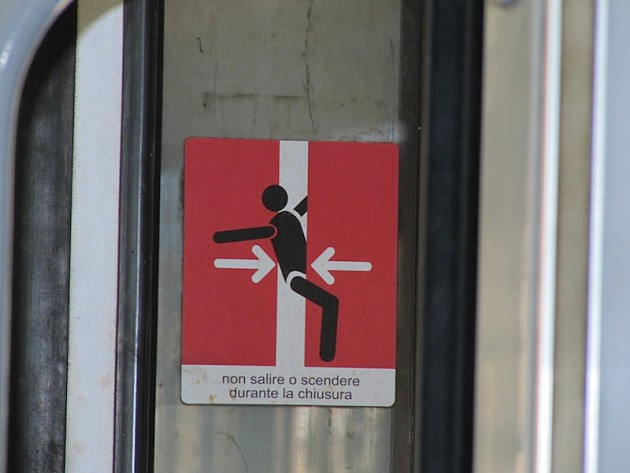 Warning sign on the train doors