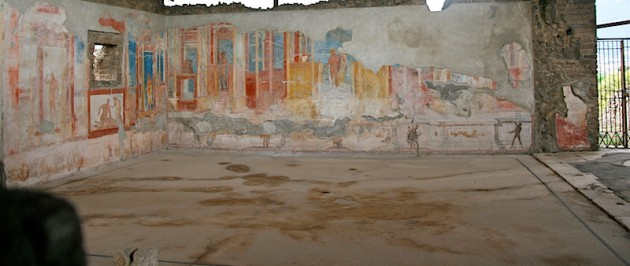 A Pompeii building interior, with faded wall painting
