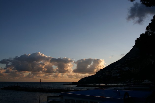 Dusk setting in over Amalfi's harbour